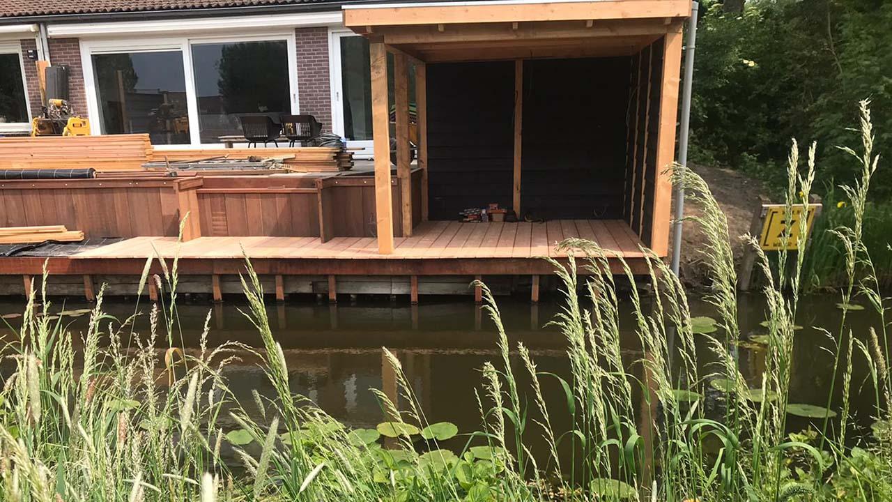 Hoefakker Hoveniers kleine tuin aan het water Uitgelicht